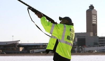 ** FILE ** Ulysses Dublin, one of four full-time Massport wildlife technicians, fires a nonlethal pyrotechnic round from a standard shotgun to disperse birds from the runways and surrounding areas at Boston's Logan International Airport in January 2009. (AP Photo/Pool, John Tlumacki)