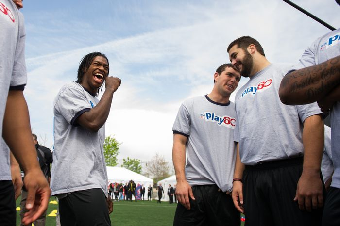 NFL draft prospects Robert Griffin III, left, Andrew Luck, second from right, and Matt Kalil, right, chat together as they and 23 other NFL draft prospects participate in a NFL Play 60 event to help teach the game of football to first through eighth grade New York City students held at Chelsea Waterside Park, New York, N.Y., Wednesday, April 25, 2012. (Andrew Harnik/The Washington Times)