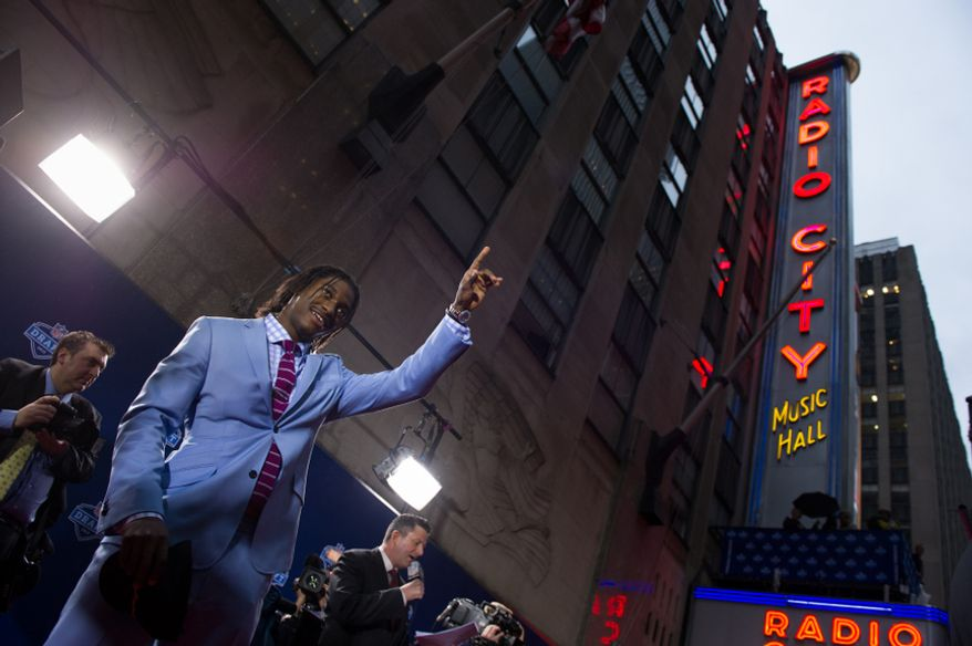 Quarterback Robert Griffin III is selected by the Washington Redskins as the second pick in the first round of the National Football League Draft held at Radio City Music Hall, New York, N.Y., Thursday, April 26, 2012. (Andrew Harnik/The Washington Times)