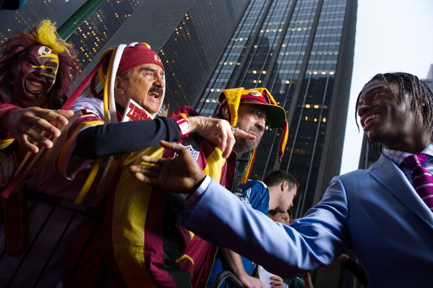 Baylor quarterback Robert Griffin III greets Washington Redskins fans as he arrives on the red carpet for the National Football League Draft held at Radio City Music Hall, New York, N.Y., Thursday, April 26, 2012. (Andrew Harnik/The Washington Times)
