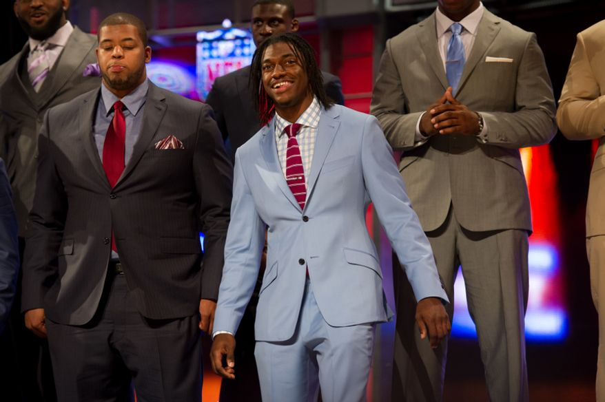 Baylor quarterback Robert Griffin III stands on stage with other top NFL draft prospects before he is selected by the Washington Redskins as the second pick in the first round of the National Football League Draft held at Radio City Music Hall, New York, N.Y., Thursday, April 26, 2012. (Andrew Harnik/The Washington Times)