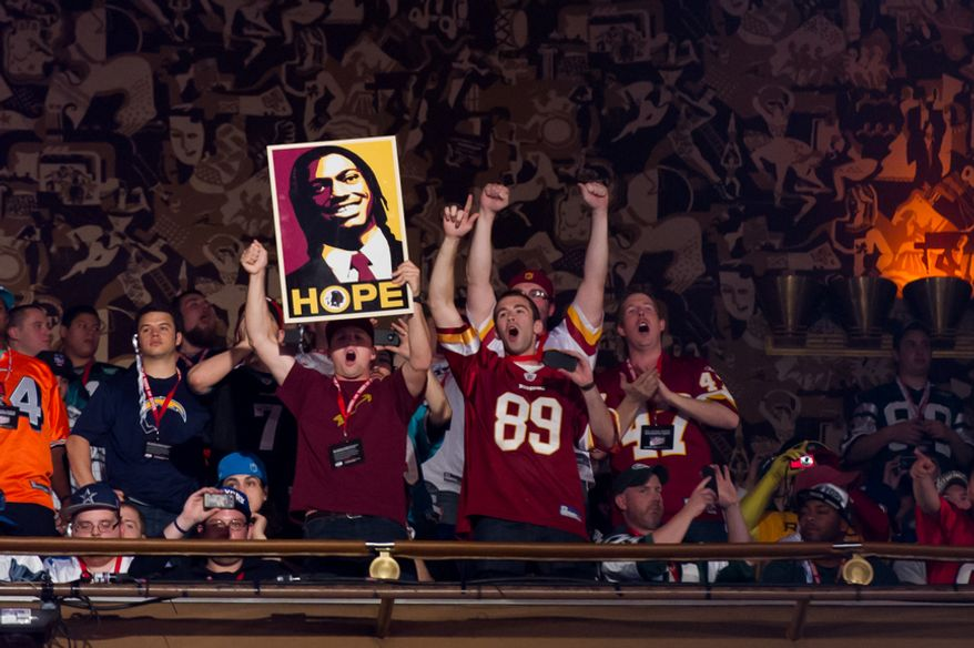 Redskins fans cheer from a top balcony as Baylor quarterback Robert Griffin III is selected by the Washington Redskins as the second pick in the first round of the National Football League Draft held at Radio City Music Hall, New York, N.Y., Thursday, April 26, 2012. (Andrew Harnik/The Washington Times)