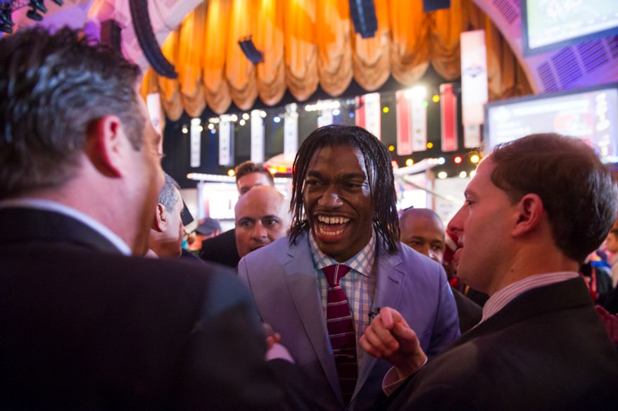 Baylor quarterback Robert Griffin III makes his way through cheering fans after he is selected by the Washington Redskins as the second pick in the first round of the National Football League Draft held at Radio City Music Hall, New York, N.Y., Thursday, April 26, 2012. (Andrew Harnik/The Washington Times)