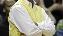 **FILE** Charlotte Bobcats majority owner Michael Jordan shouts at a referee during the second half of the Bobcats' 110-98 home win over the Sacramento Kings on Feb. 25, 2011. (Associated Press)