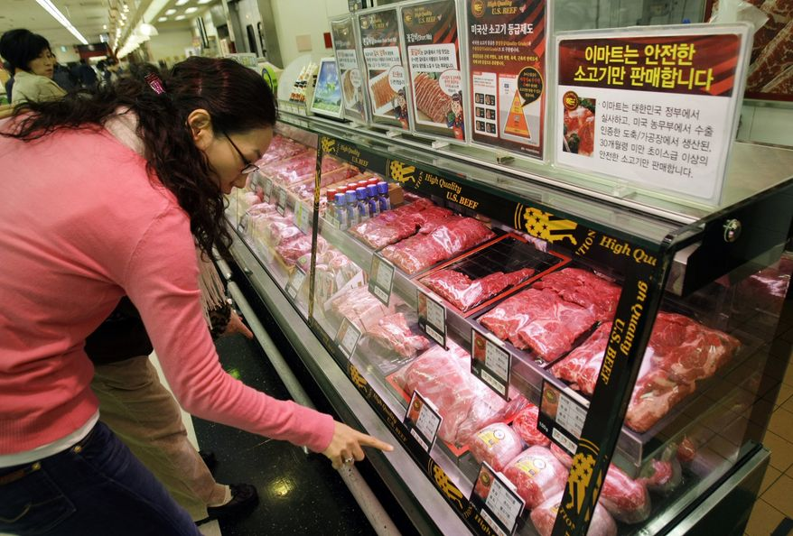 **FILE** South Korean customers look Nov. 27, 2008, at U.S. beef sold at a supermarket in Seoul. (Associated Press)