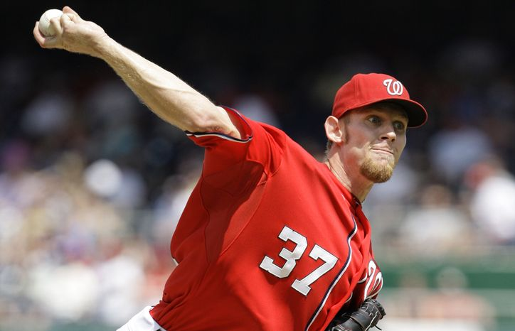 Washington Nationals starter Stephen Strasburg throws a pitch in the fifth inning against the Miami Marlins at Nationals Park in Washington on Saturday, April 21, 2012. The Nationals won 3-2 in 10th innings. (AP Photo/Jacquelyn Martin)