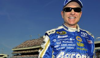 Mark Martin smiles after winning the pole during qualifying for Saturday's NASCAR Sprint Cup Series auto race at Richmond International Raceway, Friday, April 27, 2012, in Richmond, Va. (AP Photo/Autostock, Nigel Kinrade)