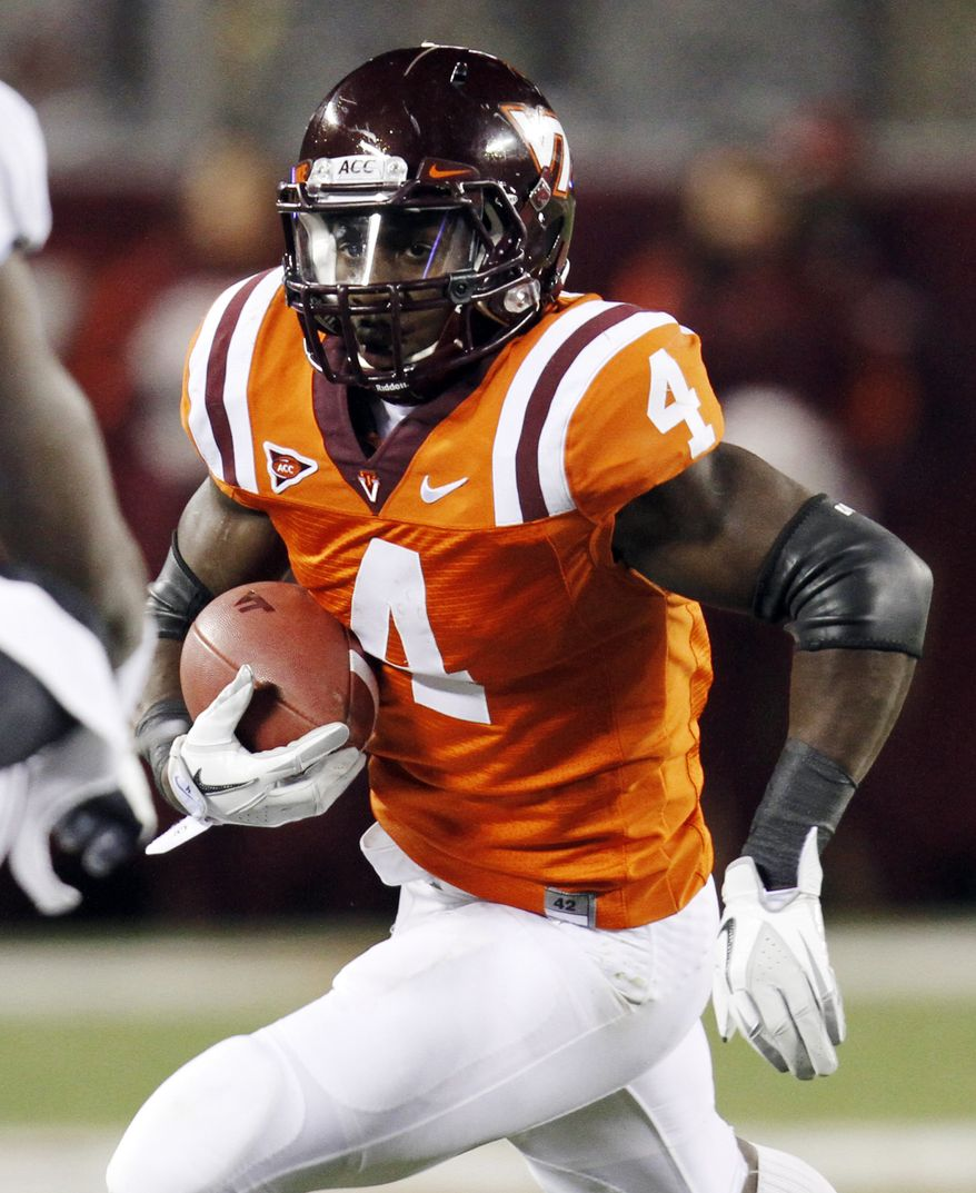 FILE - In this Nov. 17, 2011, file photo, Virginia Tech running back David Wilson (4) looks for room during the first half of an NCAA college football game against North Carolina in Blacksburg, Va. Wilson was selected as the 32nd pick overall by the New York Giants in the first round of the NFL football draft at Radio City Music Hall, Thursday, April 26, 2012, in New York. (AP Photo/Steve Helber, File)