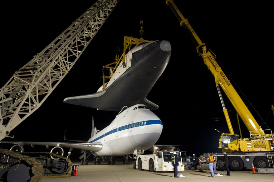 ** FILE ** In this photo provided by NASA, the NASA 747 Shuttle Carrier Aircraft moves into place underneath the space shuttle Enterprise for transport to New York at Washington Dulles International Airport, Friday, April 20, 2012, in Sterling, Va. Enterprise is expected to go on display at the Intrepid Sea Air and Space Museum in New York. (AP Photo/NASA, Bill Ingalls)