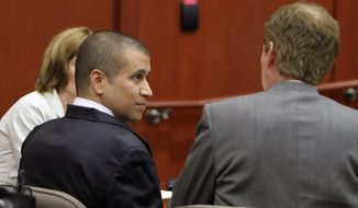 ** FILE ** George Zimmerman, left, speaks with his attorney Mark O'Mara as he appears before Circuit Judge Kenneth R. Lester Jr. Friday, April 20, 2012, during a bond hearing in Sanford, Fla. (AP Photo/Orlando Sentinel, Gary W. Green, Pool)