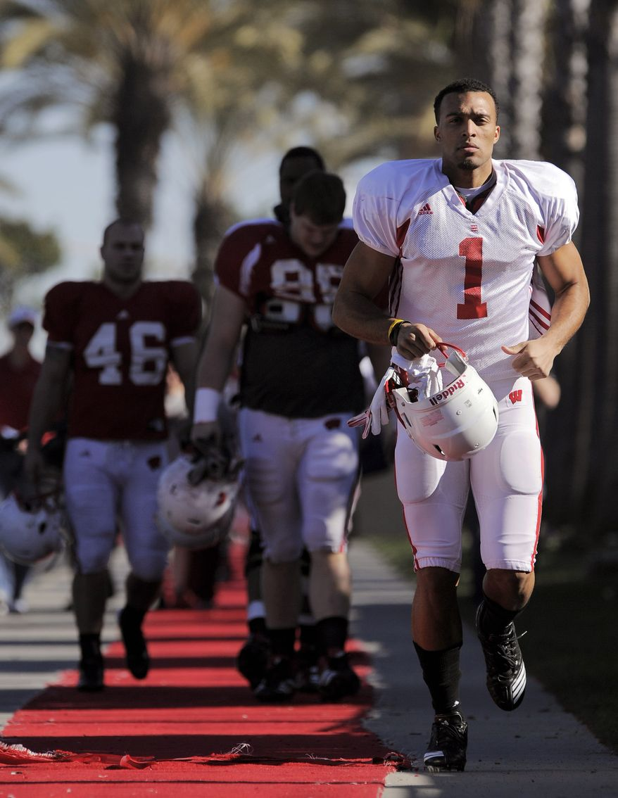 FILE- This Dec. 28, 2011 file photo shows Wisconsin Badgers wide receiver Nick Toon, right, running to practice along a red carpet in Carson, Calif. The 6-foot-2, 215-pound Toon was taken in the fourth round of the NFL draft by the New Orleans Saints.(AP Photo/Mark J. Terrill)