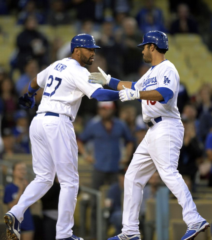 Los Angeles Dodgers' Matt Kemp, left, congratulates Los Angeles Dodgers' Andre Ethier after he hit a two-run home run during the first inning against the Washington Nationals on Friday, April 27, 2012, in Los Angeles. (AP Photo/Mark J. Terrill)