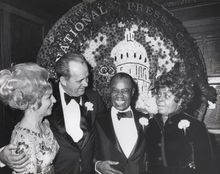 Louis Armstrong and wife Lucille are shown with National Press Club President Vernon Louviere and wife Jean, in Washington on Jan. 29, 1971. A recording of Armstrong playing his trumpet for one of the last times is being released to the public for the first time. (Associated Press)