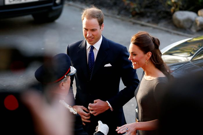 The former Kate Middleton and her husband, Prince William, attend a fundraising reception at the Imperial War Museum in London on Thursday. She is now the Duchess of Cambridge, a striking woman who is comfortable speaking in public, going to charity events or having tea with Queen Elizabeth II. (Associated Press)