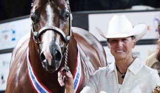Rita Crundwell, of Dixon, Ill., poses with her horse, Pizzazzy Lady, at the 2011 American Quarter Horse Association World Championship in Oklahoma City. Ms. Crundwell is charged with stealing more than $30 million to back a lavish lifestyle. (The American Quarter Horse Journal via Associated Press)