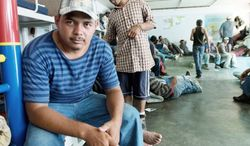 """Everything's been all right so far, but going forward, I'm afraid. Sometimes criminal guys hop on the train, and they'll rob you or kill you. ... Yeah, I'm scared."" -Victor Caseres, 26, who had traveled 750 miles by hopping freight trains  to arrive at the shelter (Keith Dannemiller/Special to The Washington Times)"