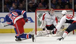 New York Rangers' Chris Kreider (20) shoots the puck past Washington Capitals goalie Braden Holtby (70) for a goal as teammate Mike Green (52) looks on during the third period of Game 1 in the second round of the NHL hockey Stanley Cup playoffs, Saturday, April 28, 2012, in New York. The Rangers won the game 3-1. (AP Photo/Frank Franklin II)