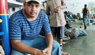 """""""Everything's been all right so far, but going forward, I'm afraid. Sometimes criminal guys hop on the train, and they'll rob you or kill you. ... Yeah, I'm scared."""" -Victor Caseres, 26, who had traveled 750 miles by hopping freight trains  to arrive at the shelter (Keith Dannemiller/Special to The Washington Times)"""