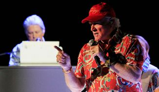 "Mike Love sings and Brian Wilson plays the piano during the opening show of the Beach Boy's 50th anniversary tour in Arizona. ""We're slaves to the Beach Boys legacy,"" said David Marks, who recorded four albums with the group. ""We're just out there trying to keep that legacy alive."" (Associated Press)"