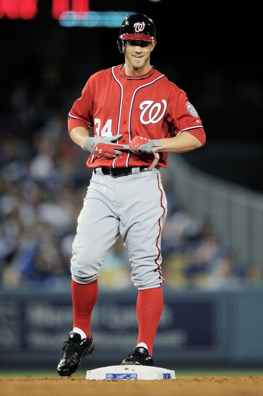 Nationals outfielder Bryce Harper doubled Saturday night for his first major league hit. He has gone 1 for 3 in each of the past two games, both Washington losses. He'll make his debut at Nationals Park on Tuesday night against Arizona. (Associated Press)