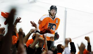 Flyers center Claude Giroux celebrates a goal in Sunday's 4-3 win over New Jersey. Philadelphia had to wait a week between playoff series after eliminating Pittsburgh in six games. (Associated Press)