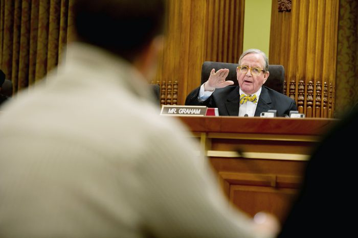 Inside, council member Jim Graham, Ward 1 Democrat, challenges bar and nightclub owners testifying in favor of extending the hours for bars and nightclubs. He proposed a tax increase on alcohol that would offset the added income of the later hours. (Andrew Harnik/The Washington Times)