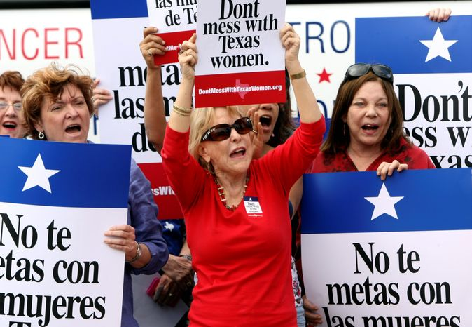 ** FILE ** Protesters rally during Women's Health Express in San Antonio in March to protest the attempt to cut Planned Parenthood out of the Texas Women's Health Program. (Associated Press)
