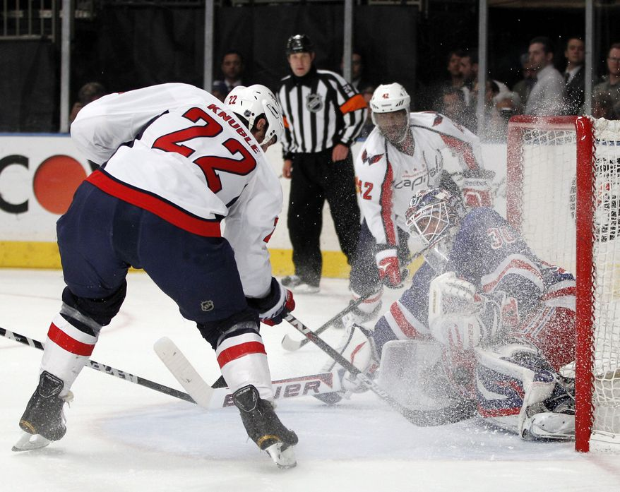 Washington Capitals right wing Mike Knuble scores the Caps' first goal on New York Rangers goalie Henrik Lundqvist, right, in the first period of Game 2 of the NHL Eastern Conference semifinals at Madison Square Garden in New York, Monday, April 30, 2012. (AP Photo/Kathy Willens)