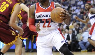 Washington Wizards guard Shelvin Mack (22) dribbles against Cleveland Cavaliers forward Omri Casspi during the first half of an NBA game, Saturday, April 14, 2012, in Washington. (AP Photo/Nick Wass)
