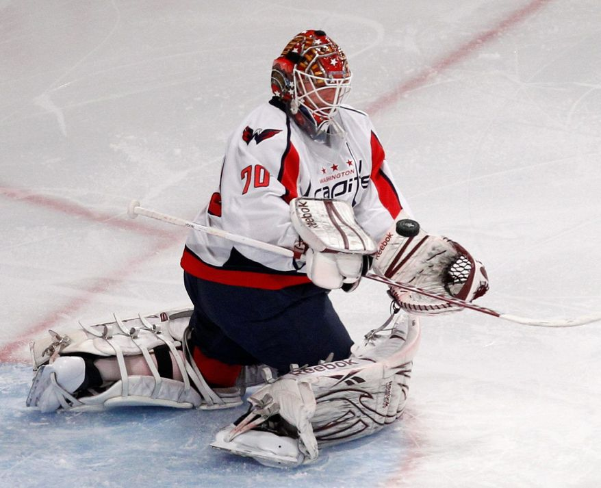 Rookie Braden Holtby turned aside 26 shots in the Capitals' 3-2 victory over the New York Rangers in Game 2. The series shifts to Washington on Wednesday. (Associated Press)