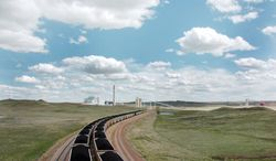 Rail cars transport coal to energy providers across the U.S. Environmentalists are trying to keep the fossil fuel inside the nation's borders and take responsibility for carbon emissions. (Associated Press)