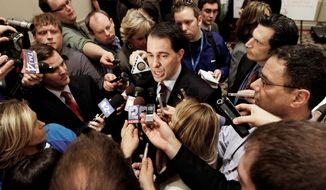 Wisconsin Gov. Scott Walker speaks at the Illinois Chamber of Commerce in Springfield, Ill., last month. Ever since his fight to pass an anti-union bill last year, Mr. Walker has kept up a jet-setting schedule that's more akin to a candidate running for president. (Associated Press)