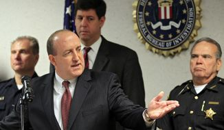 FBI Special Agent in Charge Stephen D. Anthony discusses an alleged bridge-bombing plot on Tuesday, May 1, 2012, at the bureau's Cleveland office. Five men have been arrested. (AP Photo/Mark Duncan)
