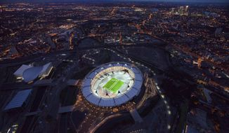 "** FILE ** In this undated photo made available on July 25, 2011, by the London Organizing Committee of the Olympic and Paralympic Games (LOCOG), an aerial photo of the London 2012 Olympic Stadium to mark ""1 year to go to the Olympic Games"" is seen in London. (AP Photo/LOCOG, Anthony Charlton, File)"