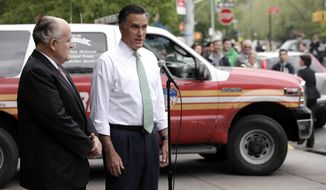 Republican presidential candidate Mitt Romney (right), accompanied by former New York Mayor Rudy Giuliani, talks to reporters in front of Engine 24, Ladder 5, in New York on Tuesday, May 1, 2012. (AP Photo/Jae C. Hong)