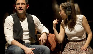 "Steve Kazee (left) and Cristin Milioti appear in a scene in the Broadway musical ""Once,"" which has garnered 11 Tony Award nominations. (AP Photo/Boneau/Bryan-Brown, Joan Marcus)"