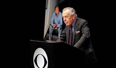 """Morley Safer of """"60 Minutes"""" speaks at the CBS News memorial service for Mike Wallace, his former colleague, at Jazz at Lincoln Center in New York on Tuesday. For nearly two hours, colleagues, friends and family members swapped stories about one of television news' best-known journalists. Wallace died at age 93 on April 7. (Associated Press)"""