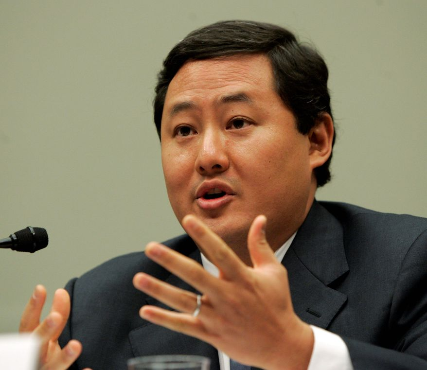 "John Yoo, the former Justice lawyer who wrote the so-called ""torture memos,"" is protected from lawsuits, the 9th U.S. Circuit Court of Appeals ruled. (Associated Press)"