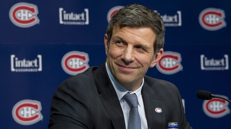 Marc Bergevin smiles as he is introduced as the Montreal Canadiens' new general manager Wednesday, May 2, 2012 in Brossard, Quebec. (AP Photo/The Canadian Press, Paul Chiasson)