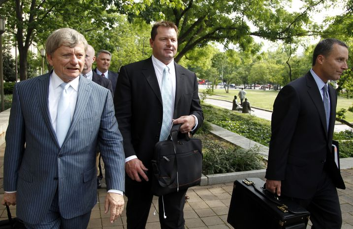 Former Major League Baseball pitcher Roger Clemens (center) leaves federal court in Washington on May 1, 2012, as his perjury retrial continues. Clemens faces charges of lying to Congress in 2008 when he said he had never used steroids of human growth hormone. (Associated Press