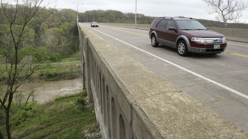Cars travel on Ohio state Route 82 across a bridge over the Cuyahoga Valley National Park in Brecksville, Ohio, on May 1, 2012. Five men were arrested the previous night for conspiring to blow up the bridge. (Associated Press)