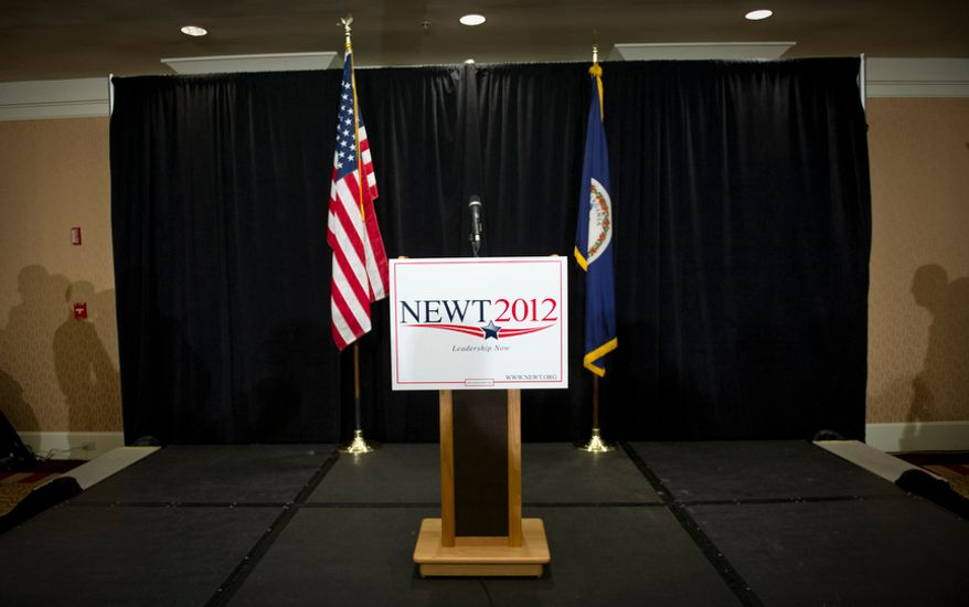 The podium stands alone onstage May 2, 2012, at the Hilton Arlington in Arlington, Va., following Republican presidential candidate and former House Speaker Newt Gingrich's announcement that he is suspending his 2012 presidential campaign. (Rod Lamkey Jr./The Washington Times)