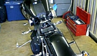 A Harley-Davidson sits in the garage in Kakuda, Niyagi Prefecture in northern Japan, in this undated photo taken by owner Ikuo Yokoyama. Japanese media said May 2, 2012, that the motorcycle lost in March 2011 tsunami washed up on a Canadian island about 6,400 kilometers (4,000 miles) away. (Associated Press/Ikuo Yokoyama via Kyodo News)