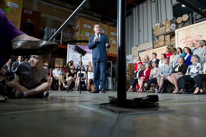 While 5-year-old Braden Jones (at left) of Leesburg, Va., plays on the floor, Republican presidential candidate Mitt Romney makes a campaign stop at Exhibit Edge in Chantilly, Va., on Wednesday, May 2, 2012. (Barbara L. Salisbury/The Washington Times)