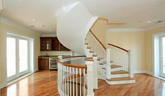 The two-level homes feature hardwood flooring, oak stairs, recessed lighting and custom-designed crown molding.