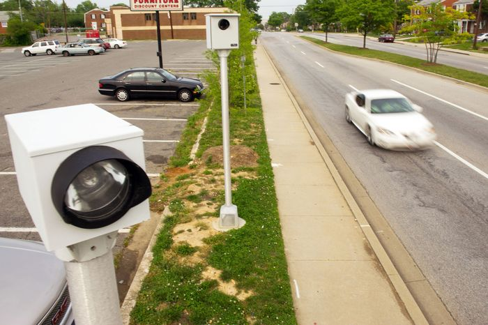 A speed camera on Iverson Street in the Hillcrest Heights area of Prince George's County stands ready Wednesday to catch motorists who exceed the posted speed limits. (Andrew Harnik/The Washington Times)
