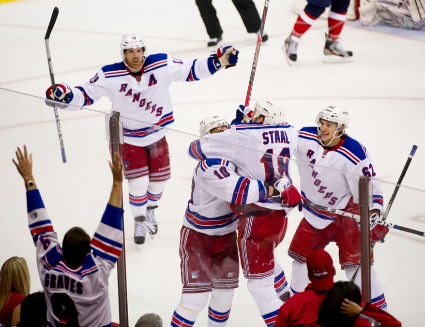 New York Rangers right wing Marian Gaborik (10), center, celebrates his goal with his teammates in the third overtime period as the Washington Capitals lose to the New York Rangers, 2-1, in playoff NHL hockey at the Verizon Center, Washington, D.C., Thursday, May 3, 2012. (Andrew Harnik/The Washington Times)