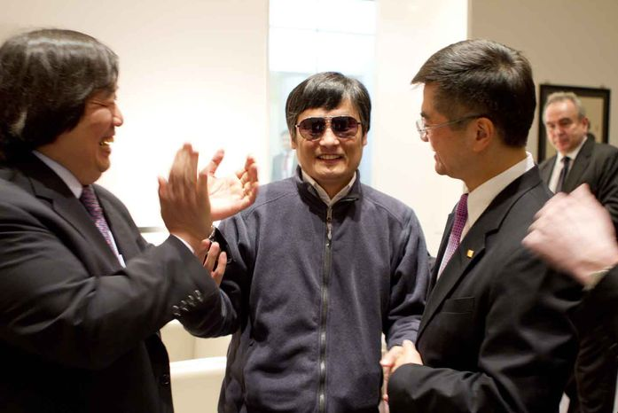 In this photo released by the US Embassy Beijing Press Office, blind lawyer Chen Guangcheng, center, holds hands with U.S. Ambassador to China Gary Locke, right, as U.S. State Department Legal Advisor Harold Koh applauds, before leaving the U.S. embassy for a hospital in Beijing Wednesday May 2, 2012. (AP Photo/US Embassy Beijing Press