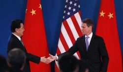 Chinese President Hu Jintao (left) shakes hand with U.S. Treasury Secretary Timothy F. Geithner during the opening ceremony of the U.S.-China Strategic and Economic Dialogue at the Diaoyutai state guesthouse in Beijing on Thursday, May 3, 2012. (AP Photo/Vincent Thian)