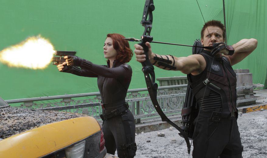 """Scarlett Johansson (left) and Jeremy Renner star as Black Widow and Hawkeye, respectively in Marvel's """"The Avengers."""" (Associated Press/Disney)"""